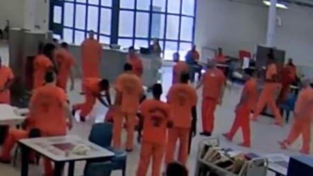 the-other-inmates-jump-in-to-the-aid-of-the-guard-who-is-being-assaulted