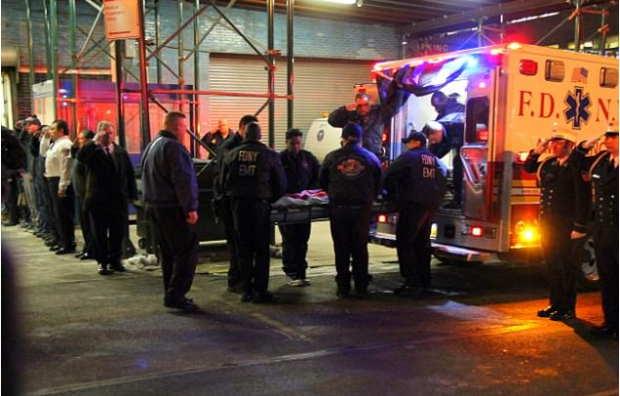 Yadira Arroyo's body is lifted from the ambulance draped in the Stars and Stripes6.png