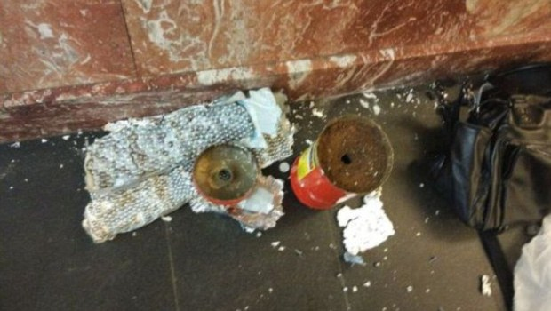 A second bomb, disguised as a fire extinguisher and packed with ball-bearings, was found and defused at a nearby station1