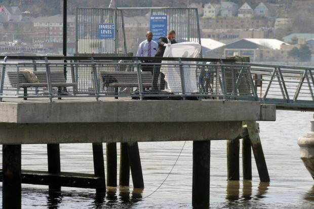 Detectives remove the body of the appeals court judge from the Hudson River Wednesday on the W. 125th St. pier