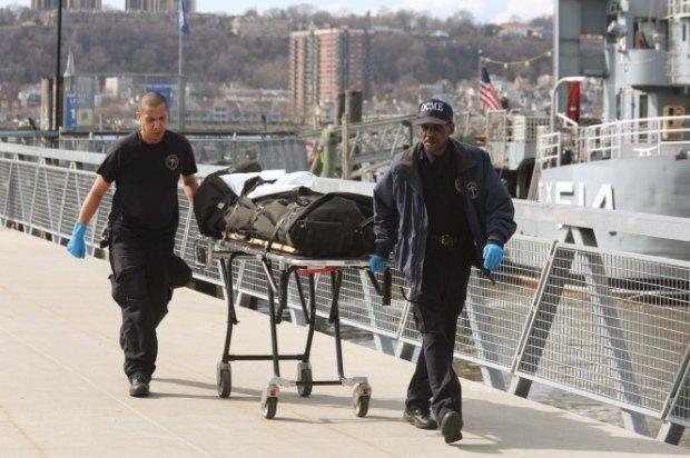 Medical examiners remove Abdus-Salaam's body..jpg