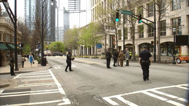 Police activity at the intersection where Trinh Huynh was killed by a gunman .png