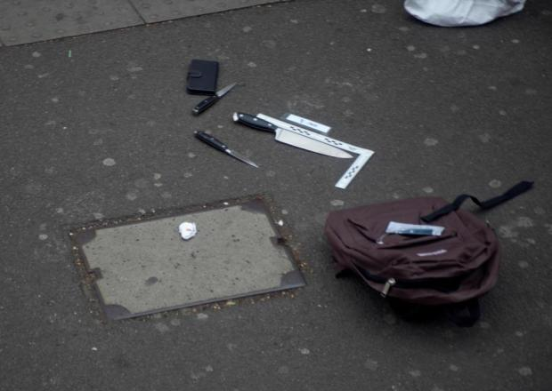 The rucksack and knives left in Whitehall after armed officers swooped on a terror suspect.jpg