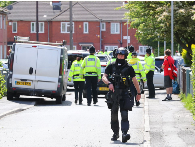 A huge number of police, including armed officers, carried out a raid on a house in the Fallowfield area of Manchester.png