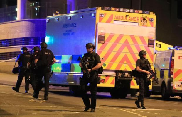 Armed police arrive at venue.jpg