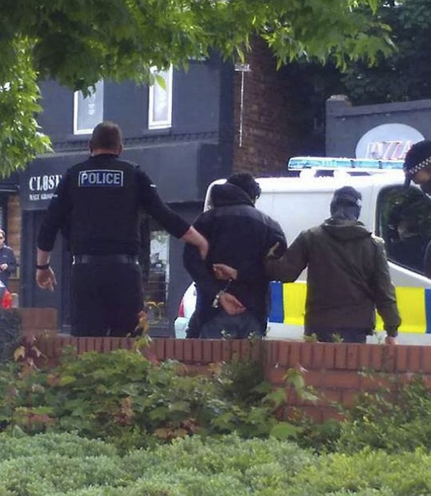 Armed police in Chorlton, Manchester arrested a man believed in connection with the terror attack at the Manchester Arena last night .jpg