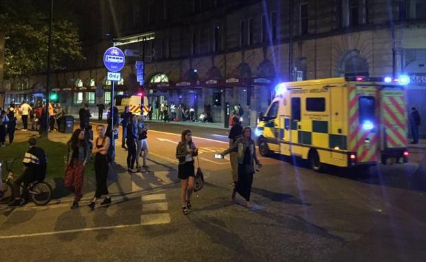 Concert goers flee Ariana Grande concert venue in panic