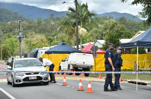 Cops cordoned off the area after they were called to the scene of the killings.jpg