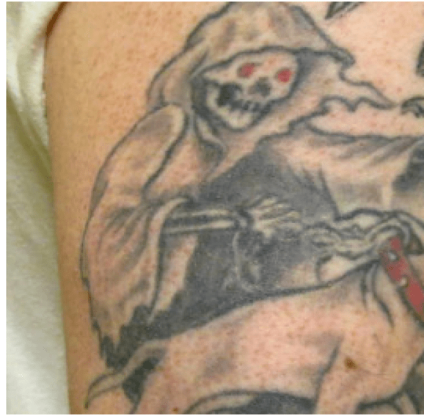 Fear Me tattoo on gang members' bodies.png