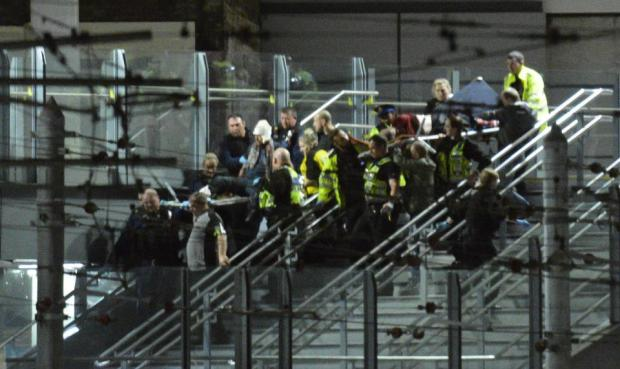 Injures concert goesrs are evacuated.jpg
