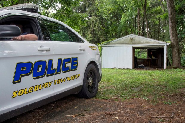 police guard garage where car was found.JPG