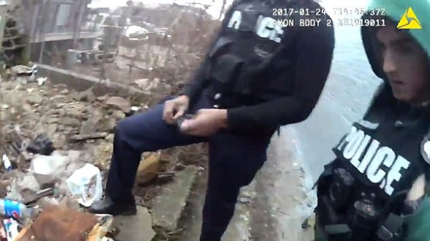 Baltimore police officer planting 2.jpg
