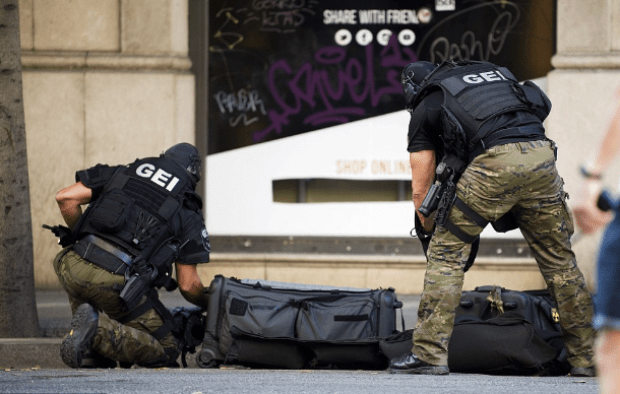 Police special forces work near Plaza Catalonia following the incident, which police are treating as a terror attack.png