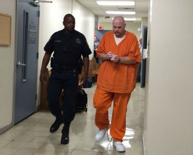 Christopher Matthew Henderson leaves the Madison County Courthouse Tuesday, Sept. 29, 2015.jpg