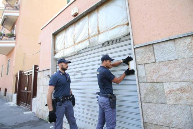 Cops are pictured sealing up the office space where the alleged kidnapping occurred