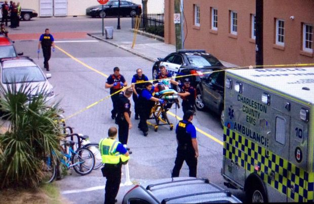 EMTs strercher off an injured person in Charleston shooting.jpg