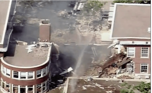 explosion at Minnehaha's Upper School (pictured) gouged a massive hole in the building and left two people unaccounted for.png
