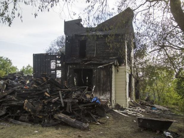 It took firefighters 15 hours to put out the blaze that killed the two girls and injured two older relatives 2 .jpg