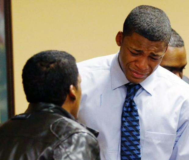Ma'lik Richmond stands with his father after he was convicted last March 2013.