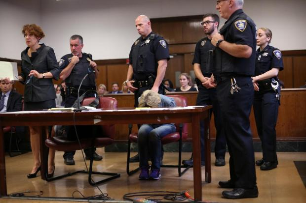 Pilmar hangs her head as she's arraigned Tuesday in her husband's cold-case murder Aug 15