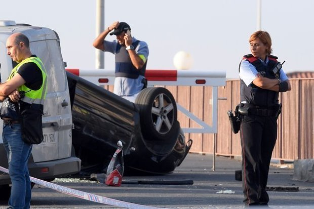 Police inspect vehicle used in El Cambria terror attack.jpeg