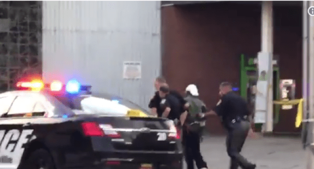 Police take main into custody after Judge Joseph J. Bruzzese Jr. was shot Monday morning.png