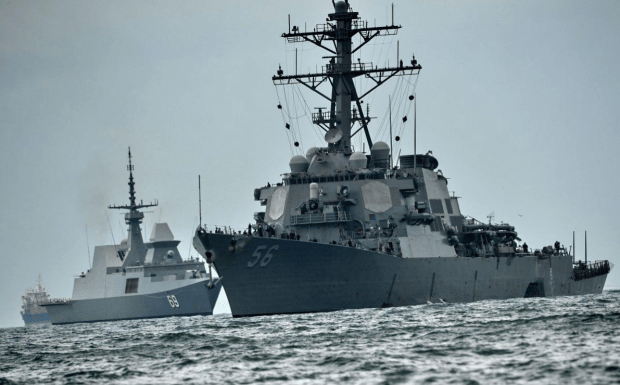 USS John S. McCain was brought back to Singapore after the collision..png