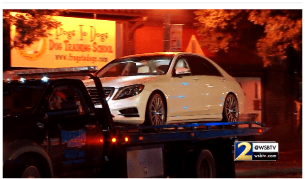 Young Mazi's car is towed away
