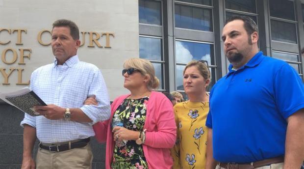 Laura Wallen's father, Mark Wallen, speaks to the media, accompanied by mother Gwen