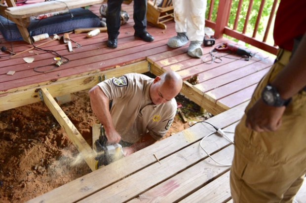 Mobile County Sheriff's Office investigators dig underneath the home of missing woman Susan Mayo.jpg