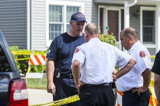 Police at the home after Eric Ringenberg killed his two sons and set the home on fire