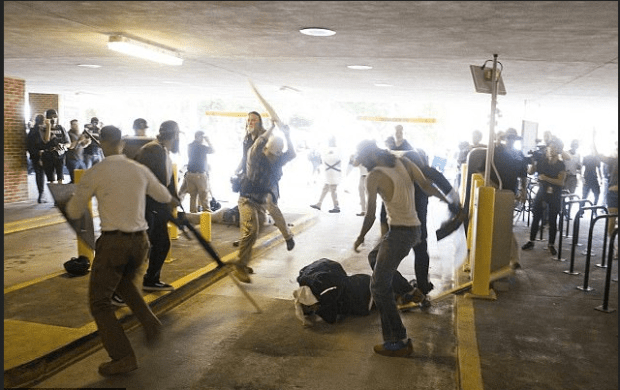 DeAndre Harris, on the ground set upon by horde of white suprenacists in Charlottesville VA