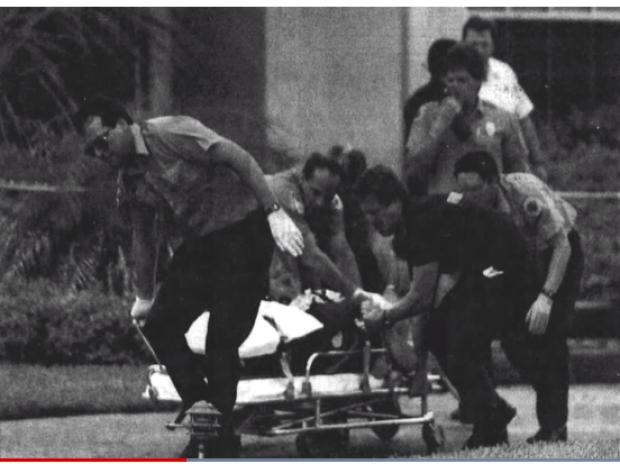 Marlene Warren being wheeled away