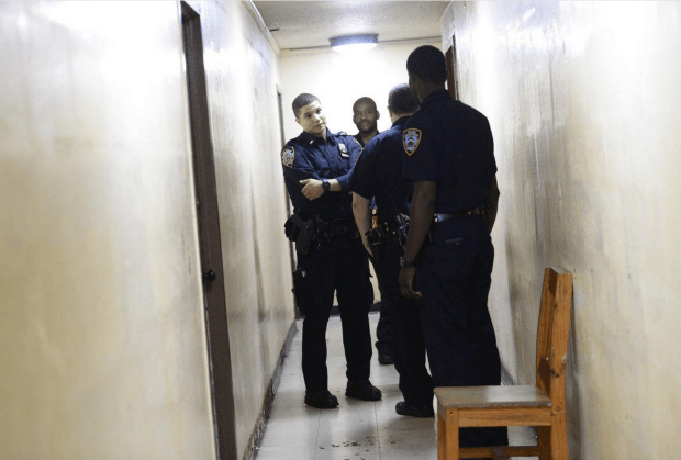 Police inspect dried blood in the hallway, a day after the killing.png