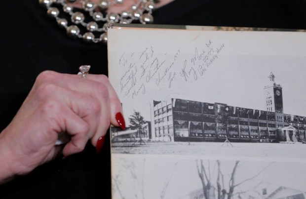 Beverly Nelson shows a school yearbook signed by Roy Moore.jpg