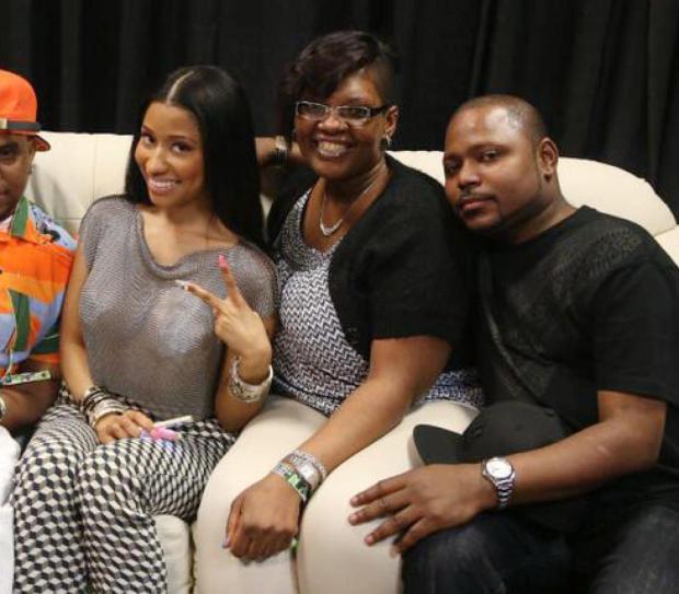 Nicki Minaj, her brother Jelani Maraj [right] and his wife, Jacqueline Robinson [center], in 2014.jpg