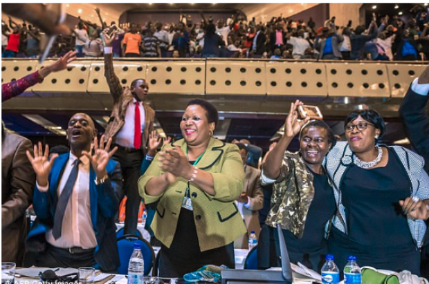 Party time as lawmakers in Harare hug, applaud and laugh in relief after Mugabe's resignation.png