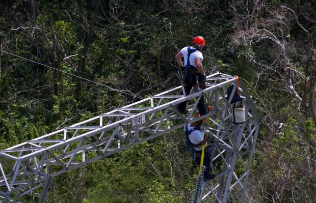 Whitefish Energy Holdings workers are seen working on power lines damaged by Hurricane Maria in Puerto Rico,.jpg