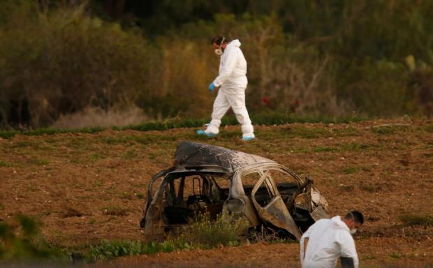 Forensic experts at the site of the explosion that killed Daphne Caruana Galizia .jpg