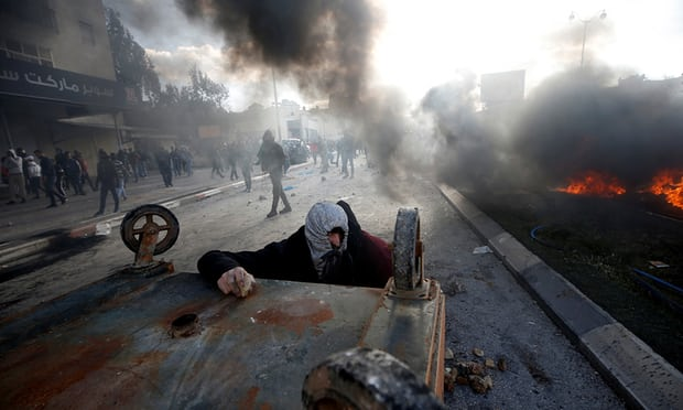 Palestinian protesters during clashes with Israeli troops in Beit El, near Ramallah.jpg