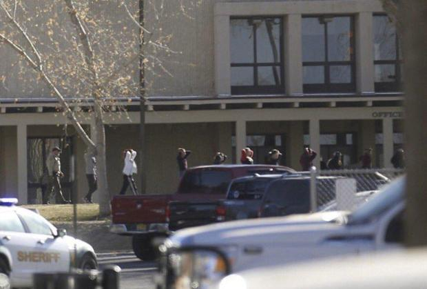 Students are led out of Aztec High School in NM, after the shooting on Dec 7.jpg