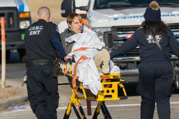 A man is wheeled away on a gurney toward an ambulance after Stephen Walker's truck crash 1.jpg