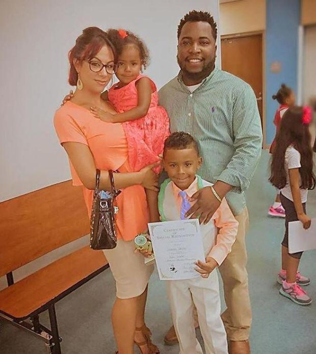 Christina Treadway with three-year-old Iliya Miller, Isaiah Miller, 7, and their dad.jpg