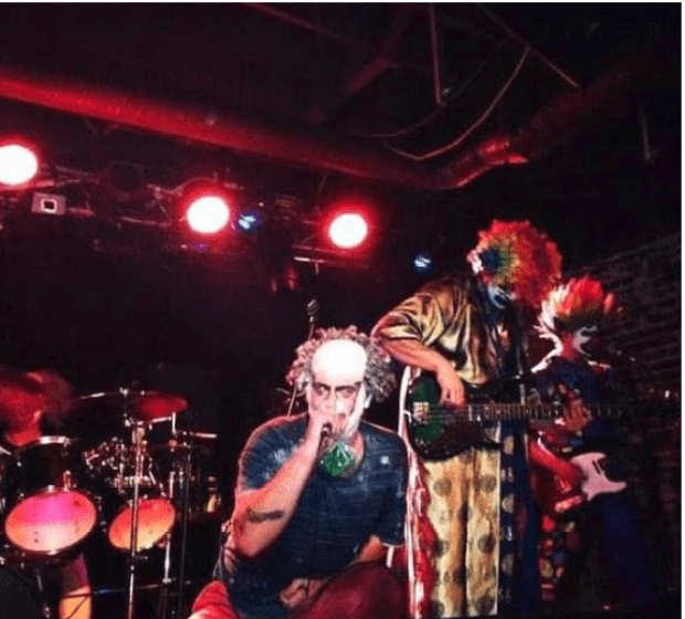 Daniel Whitmore and other band members of Powerclown on stage.png