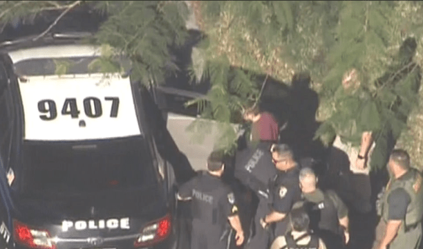 Nicolas Cruz, the suspect in maroon is taken into custody 15.png
