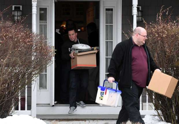 FBI and state police take cart evidence from the home of NXIVM co-founder Nancy Salzman on March 27 .jpg