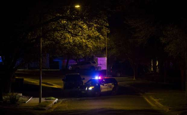 Law enforcement officers gather at the scene of the fourth bombing Sunday night 32