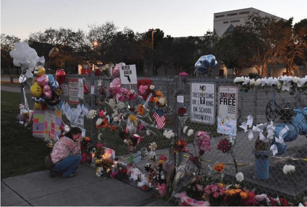 Melissa Goldsmith weeps outside Marjory Stoneman Douglas High School on Feb. 18.