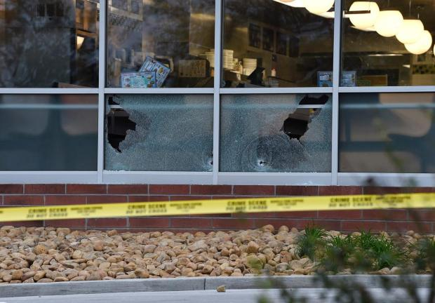 Bullet holes are seen at the Nashville Waffle House.jpg