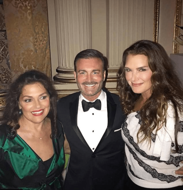 Benjamin Ruiz [centre], is pictured with Mercier [left] and Brooke Shields [right].PNG